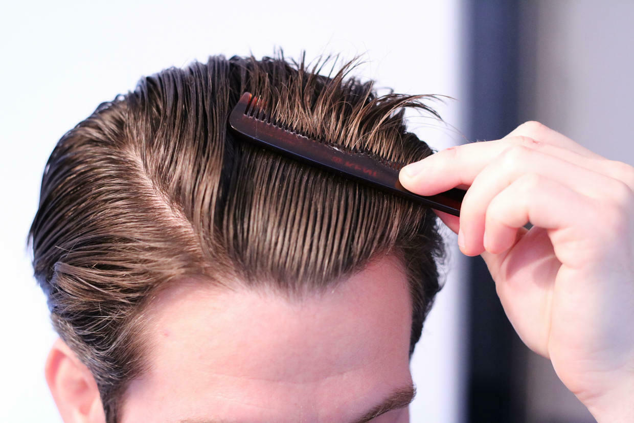Combing hair back