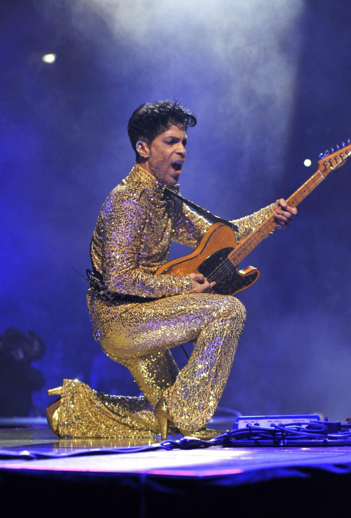 Prince wearing gold sequins