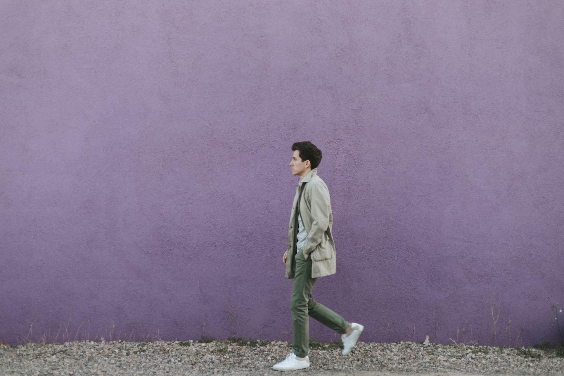 Walking in front of purple wall