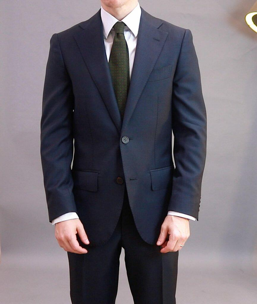 Suit Supply ready-to-wear suit; notice the wrinkly sleeves and shoulder divots