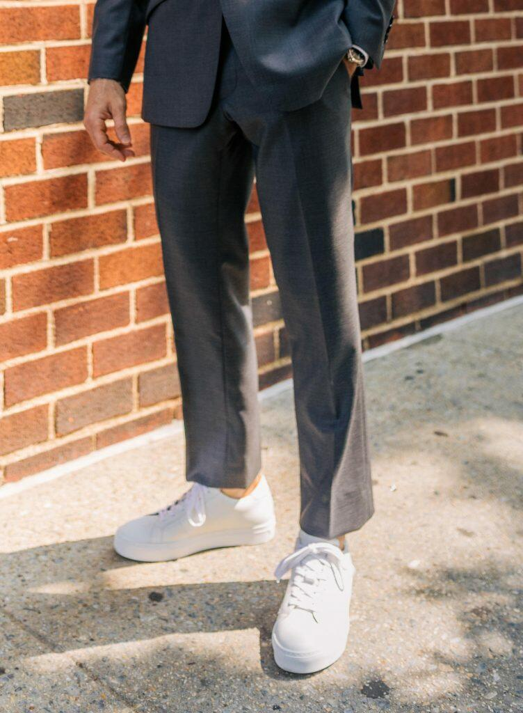 White sneakers with grey suit