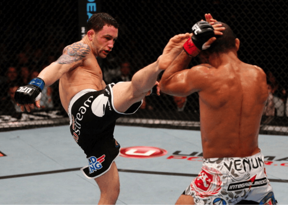 Short UFC fighter Frankie Edgar delivers a kick in a UFC 156
