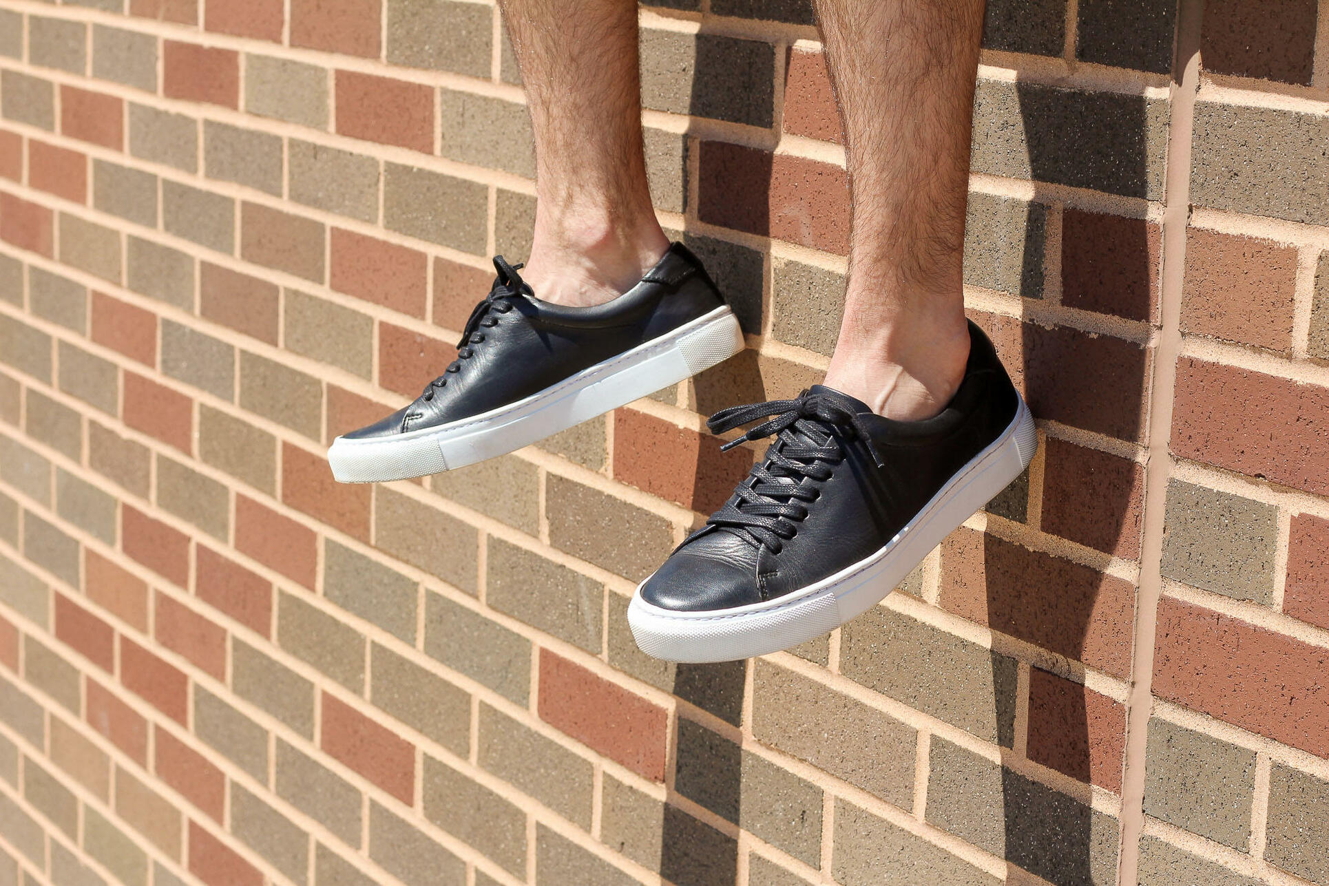Going sockless with leather sneakers
