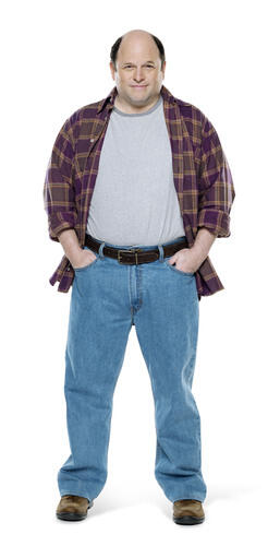 Short stocky man in relaxed fit jeans