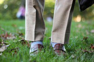 Tan trousers with brown loafers