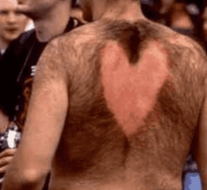 Hairy man with heart shaped back wax